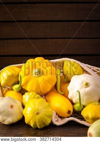 Fresh Harvest Of Zucchini And Pattypan Squash, Yellow Squash And Pattison And Pepper On Wooden Backg