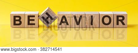 Behavior Word Made Of Building Blocks On A Light Yellow Background