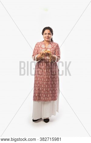 Indian Asian Middle-aged Woman Holding Precious Gold Jewellery Ornaments