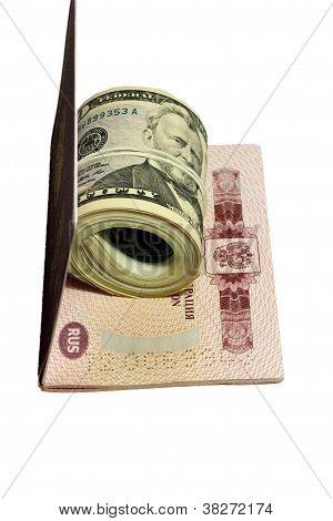 Stack Of Paper Usa Dollars Inside Thr Red Passport