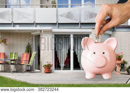Real Estate Investing Financial Plan. Saving Coin In Piggybank