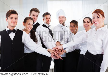 Diverse Team Of Waiters And Hospitality Staff People In Uniform
