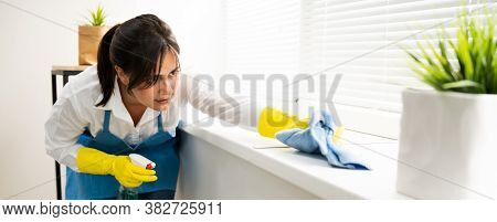 Professional House Cleaning Service. Room Cleaner And Housekeeper