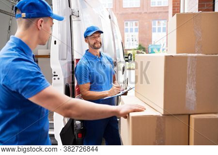 Van Courier And Professional Movers Unload Truck