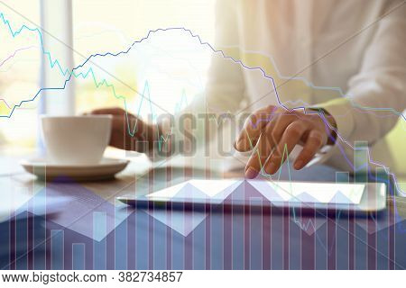 Forex Trading. Double Exposure Of Charts And Woman Using Tablet Computer, Closeup