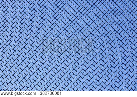 Old Wire Fence Made Of Thin Wire Against The Blue Sky, Fencing Private Territories And Private Prope