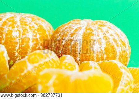 Cleaned From The Peel Tasty Oranges Are Ready For Eating, The Pieces Lying On The Table, Close-up