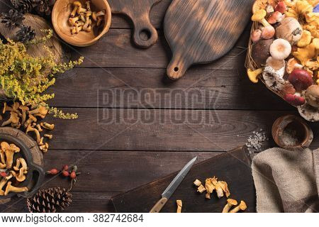 Autumn Harvest Of Mushrooms On Vintage Rustic Wooden Background. Rustic Kitchen Table. Flat Lay Top,