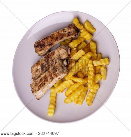 Grilled Pork Ribs With French Fries On Light Gray Plate. Pork Ribs With French Fries On A White Back