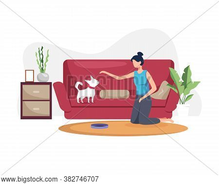 Young Woman With Her Dog At Home. Young Woman Playing With Dog In The Living Room. Woman Spends Time