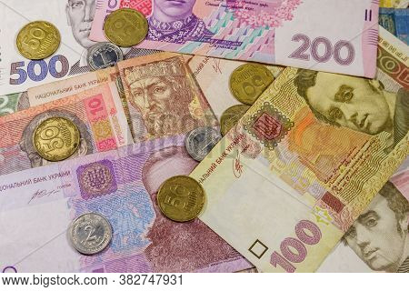 Ukrainian Currency. Background Of Different Ukrainian Hryvnia Banknotes And Coins