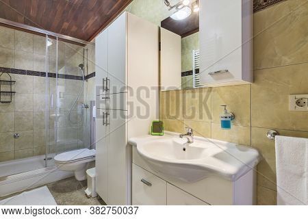 Interior Of Modern Bathroom And Shower, Side View