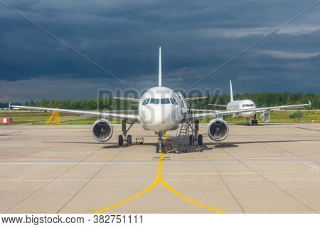 Aircraft Maintenance Parked In The Open Air Airport, Engine Repair And Mechanics Check Testing