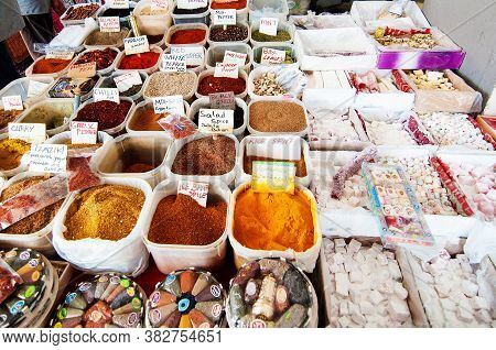 Heaps Of Colorful Spices On The Counter. Closeup Of A Counter With A Big Variety Of Spices On The An