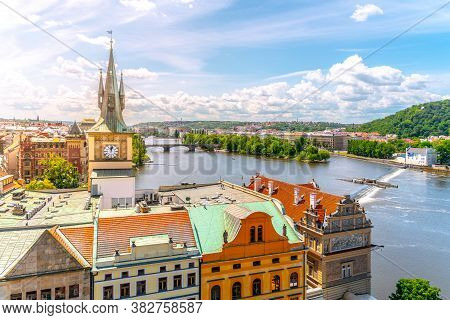 Vltava River And Old Town Waterworks Tower In Prague, Czech Republic.