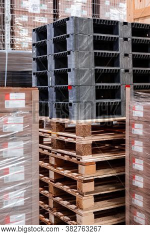 Wooden Boxes And Wooden Pallets In The Warehouse. Boxes Out Of Wood For Packing Industrial Machinery