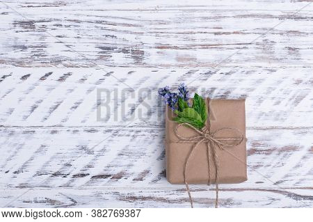 Gift And Posy Of Lavender On Wooden Background