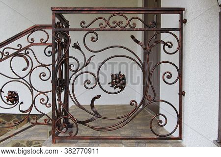 Stairwell With Wrought Iron Railings, Stairs With Wrought Iron Railings And Ceramic Tiles