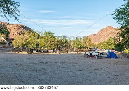 Ai-ais, Namibia - June 17, 2011: View Of The Camping Area At Ai-ais. Vehicles, People And Tents Are
