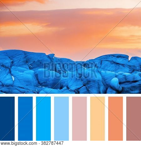 Detail of the blue glacial ice of Svinafellsjokul glacier, Iceland, at sunset. In a colour palette with complimentary colour swatches.