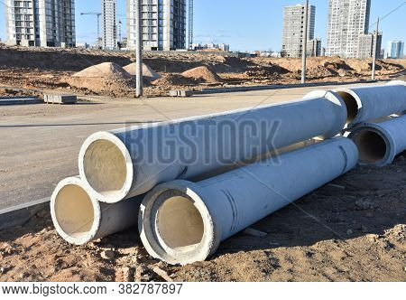 Concrete Drainage Pipes At The Construction Site. Laying Of Underground Storm Sewer Pipes. Installat