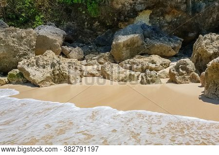 Day View On Stones And Rocks And White Sand On Karma Beach On Bali, Indonesia