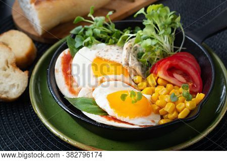 Healthy Food Super Breakfast Concept  Fried Eggs And Micro-green Salad With Corn And Tomato In Skill