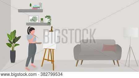 Woman Using Weekend Holiday With Drawing At Living Room. She Thinking About What To Draw.