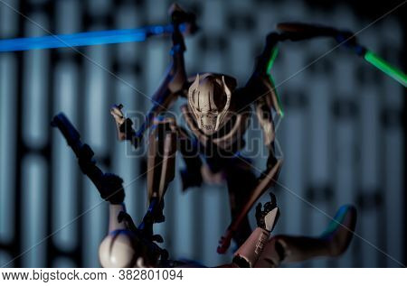 AUGUST 23 2020: AUGUST 23 2020: Star Wars Clone Wars Separatist General Grievous battling a clone trooper with his lightsabers - Hasbro action figures