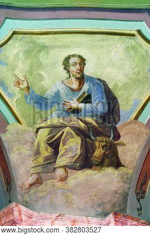 OROSLAVLJE, CROATIA - MAY 27, 2013: Saint Luke the Evangelist, fresco in the parish church of the Assumption of the Virgin Mary in Oroslavlje, Croatia