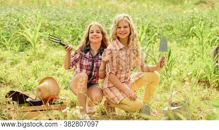 Planting And Watering. Rustic Children Working In Garden. Agriculture Concept. Growing Vegetables. P