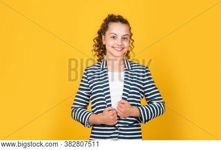 Clever Girl. Girl School Pupil Wear Formal Style Jacket Yellow Background. Adorable Nerd. Schoolgirl