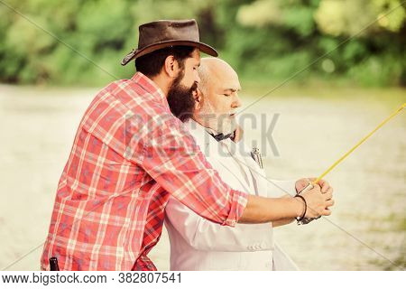 Bearded Man And Elegant Businessman Fish Together. Learn To Fish. Fish With Companion Who Can Offer