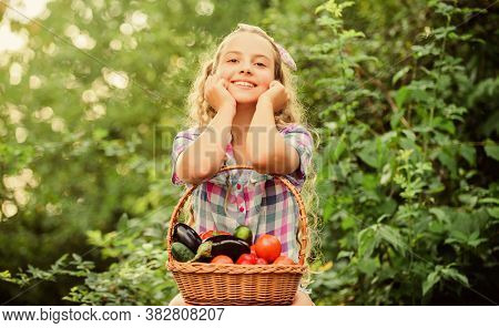 Healthy Lifestyle. Kid Hold Basket With Vegetables Nature Background. Eco Farming. Eat Healthy. Summ