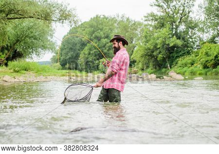 Summer Weekend. Big Game Fishing. Bearded Fisher In Water. Hobby And Sport Activity. Pothunter. Matu