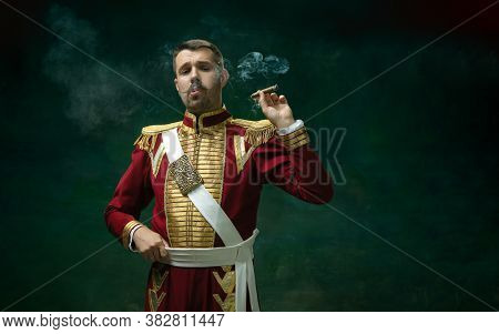 Smoking Cigarette. Young Man In Suit As Nicholas Ii Isolated On Dark Green Background. Retro Style,