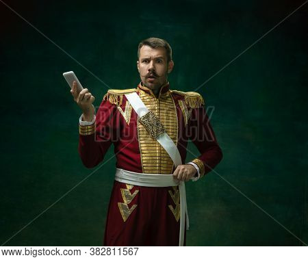 Shocked Scrolling Phone. Young Man In Suit As Nicholas Ii On Dark Green Background. Retro Style, Com