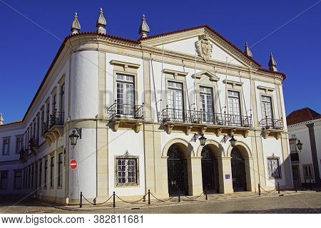 Faro, Portugal - December 28, 2019: Town Hall Of The Portugese City Of Faro Against A Clear Blue Sky
