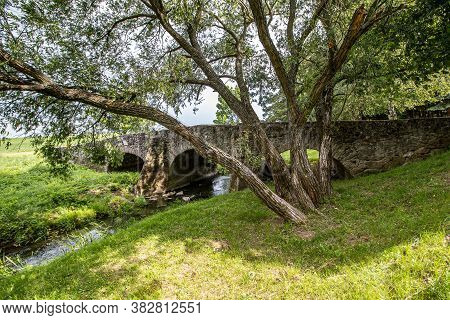 Three-arch Stone Bridge From The 16th Century. From The Period Of The Raids On Europe And Is Known A