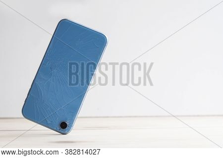 Mobile Cell Phone Falls From Hands And Crashes On Stairs, On Asphalt. Broken Smartphone Falling To T