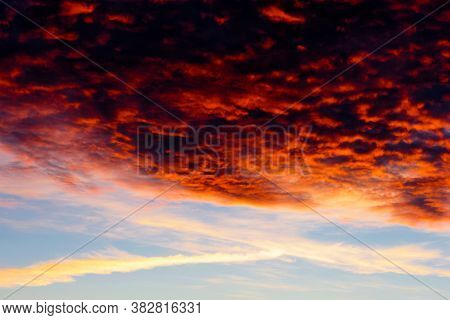 Clouds At Sunset Illuminated By The Sun From Below. Blazing Sky, Dramatic Sunset. Sky Is Like A Conf
