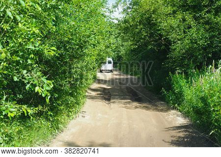 Car Driving On A Country Road In The Forest, Off Road, Summer Adventure