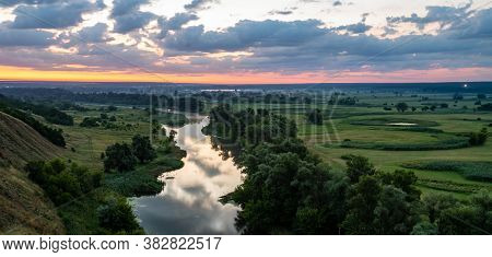 Panoramic View From Hill Of Fantastic Landscape Of Dramatic Colorful Sky, Amazing Sunset. Beautiful