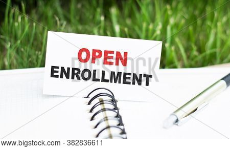 Open Enrollment Words On A Card In A Notebook