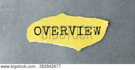 Word Overview On A Yellow Piece Of Paper.