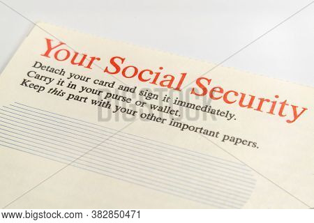 Macro view of iinstructions on old social security card paper mailer.