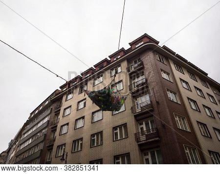 Plastic Bottles In A Fisher Net Art Installation Above The Streets Of Prague, Czech Republic To Rais
