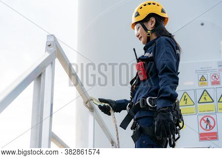 Asian Woman Inspection Engineer Wearing Safety Harness And Safety Line Working Preparing And Progres
