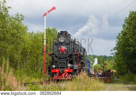 Ruskeala, Russia - August 15, 2018: Soviet Steam Locomotive Lv-0522 And Retro Train