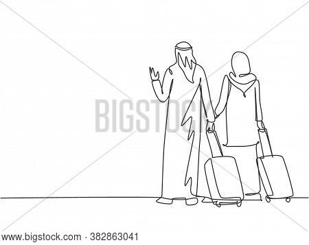 One Continuous Line Drawing Of Young Male And Female Muslim Couple Do Business Trip To Abroad Togeth